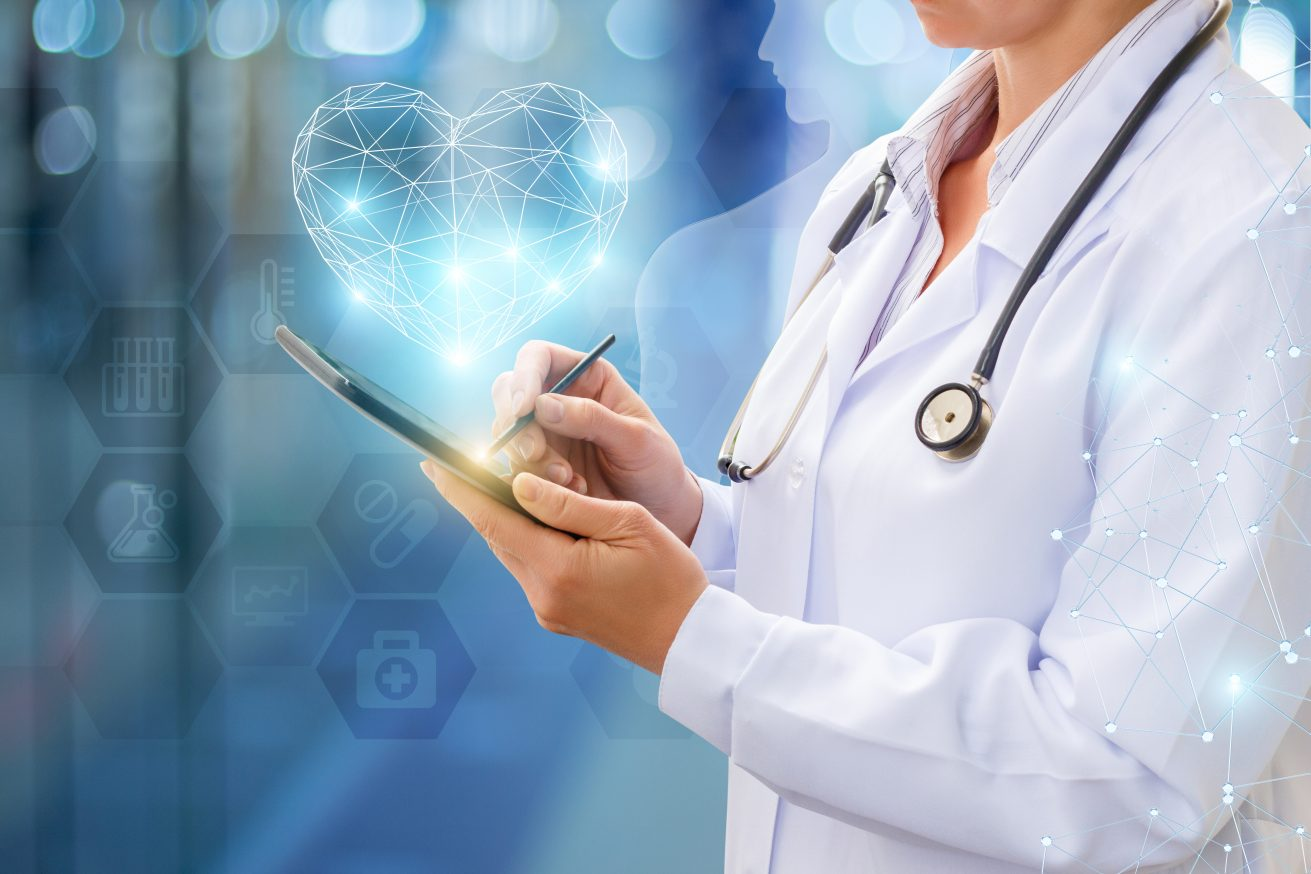 Doctor works on your computer on blurred background.